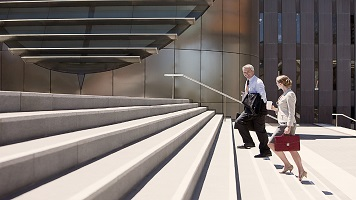 Business people walking up steps